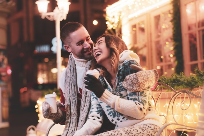 Couple laughing outside in the winter